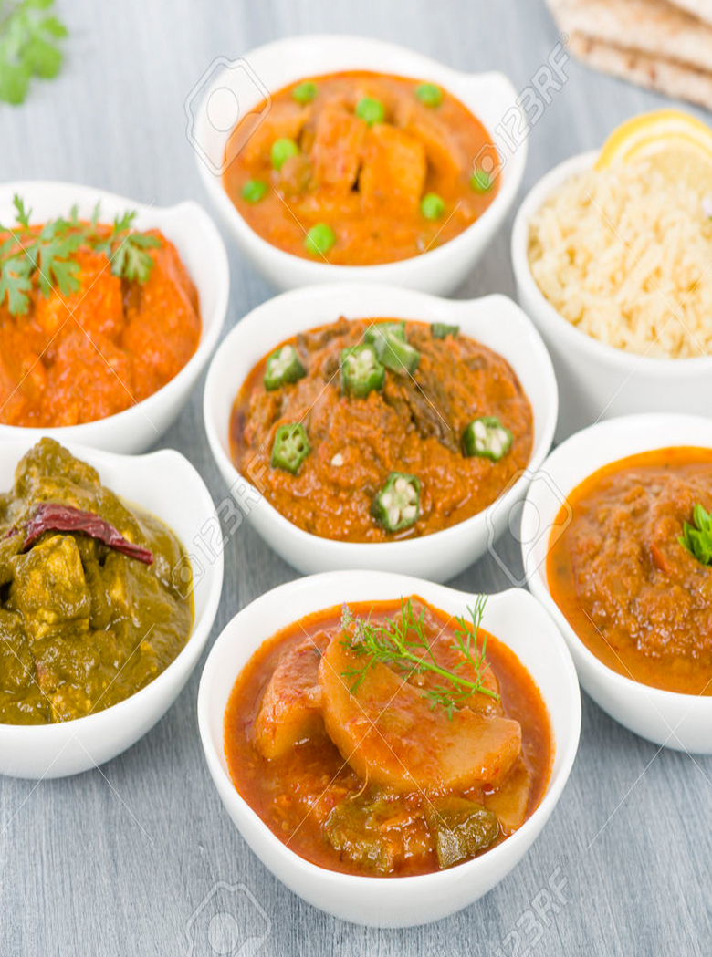 49876620-Vegetarian-Curries-Selection-of-South-Asian-vegetarian-curries-in-white-bowls-Paneer-Makhani-Palak-P-Stock-Photo